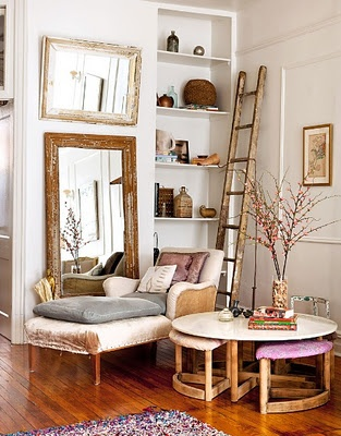 cozy corner. bookcase, ladder, mirrors, chaise lounge and round coffee table with