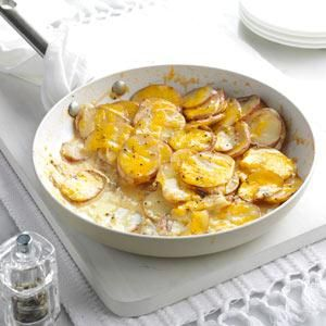 Skillet Scalloped Potatoes - Our garden is a big inspiration when I'm cooking. This recipe turns produce from my husband's potato patch into a side dish we want to eat at every meal. —Lori Daniels, Beverly, West Virginia