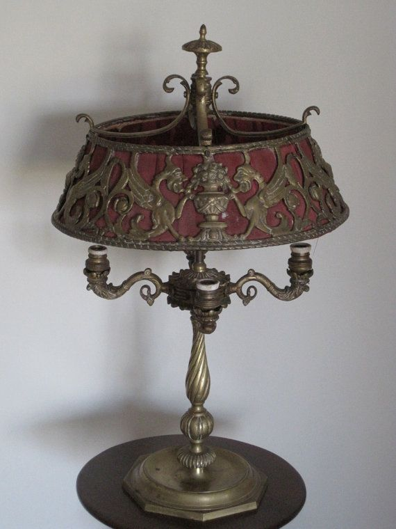 Love lamps. Love antiques. If I could only think of a place to put this...and had the money to buy it.