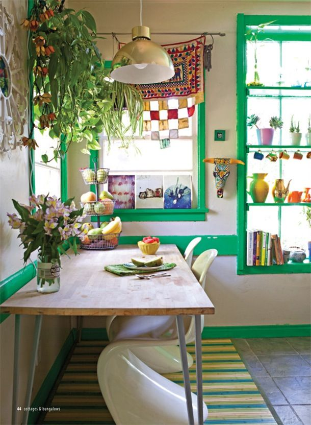 Green trim emphasizes this kitchen's whimsical, bohemian attitude, from The Jungalow. If you attempt a similar look, tape around the molding carefully before painting so you don't wind up with bright splotches on the rest of the wall.