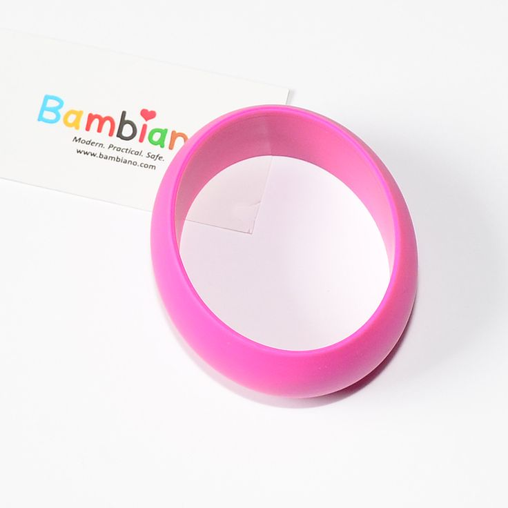 Bambiano Hoola Bangle in Hot Pink. Bambiano Bangles are made of 100% Food grade silicone. BPA free, Lead free and nontoxic. Fashionable for Mums and safe for teething babies to chew on. Bracelets are washable and soft on baby's gums. Shop at www.bambiano.com