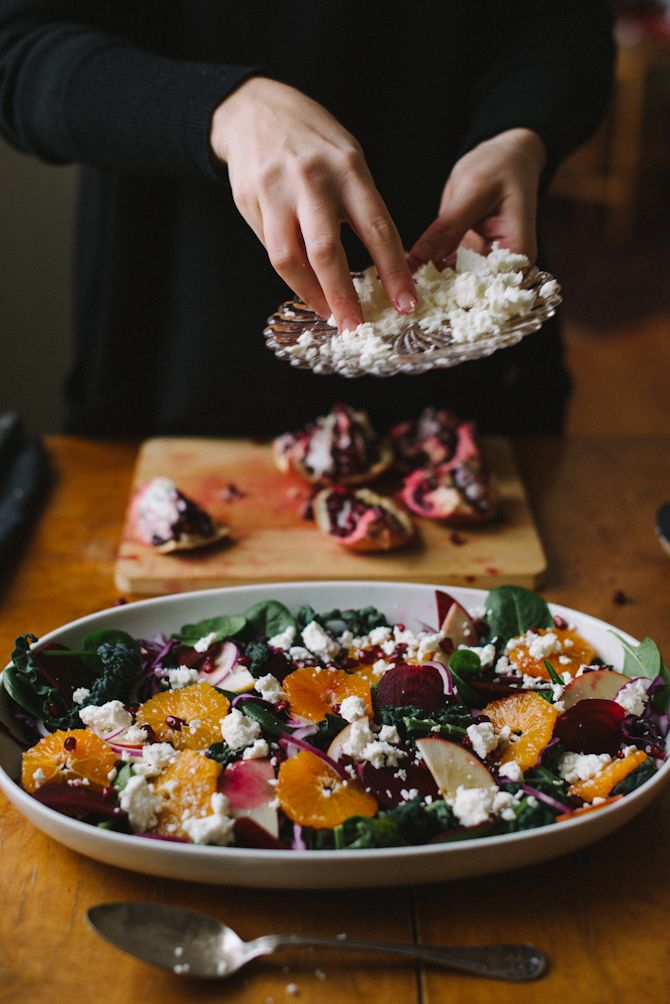 Winter Salad by Babes in Boyland: black cabbage, Baby spinach, red cabbage, 1 red onion, 1 apple, 1 orange, 1 beetroot, 1 pomegranate, feta cheese. For serving: pumpkin seeds, balsamic vinegar, olive oil, salt and pepper.