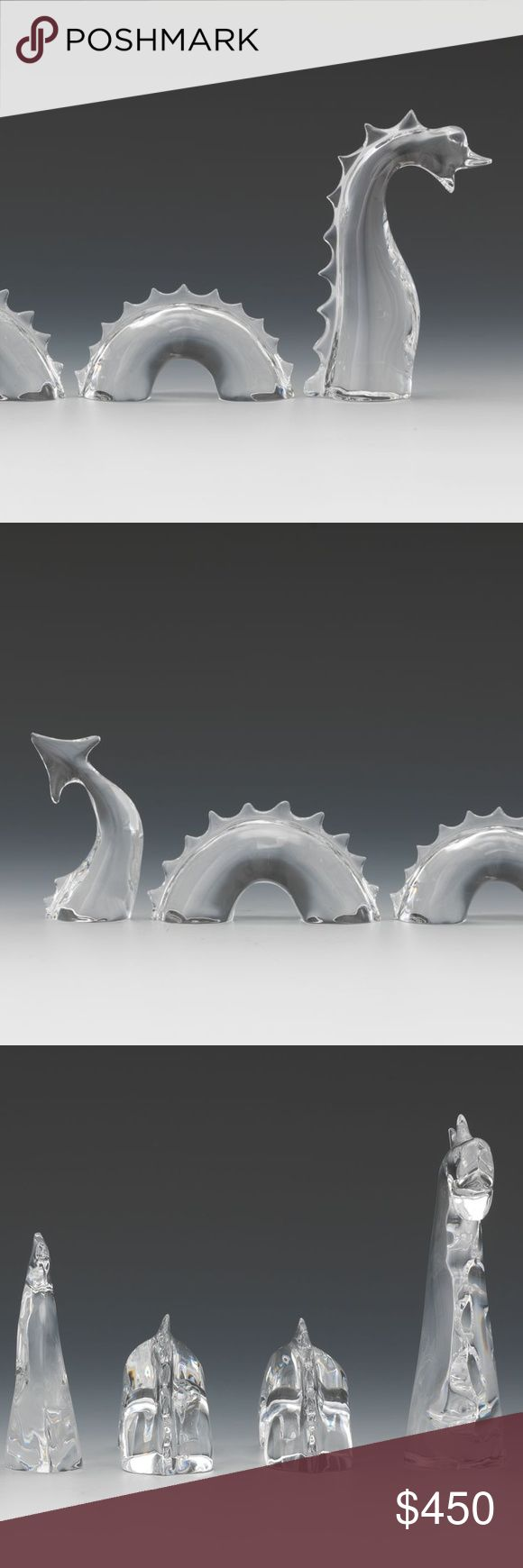A Four Piece Baccarat Crystal Sea Monster A Four Piece Baccarat Crystal Sea Monster  The head and neck, 3 ¾ x 2 in Two curved body pieces, 1 ⅜ x 3 ¼ in  The tail 2 ½ x 1 ½ in  Perfect Condition, we don't have original box. There are no chips, no cracks, no breaks, no repairs, no flakes. Please examine all our pictures as a part of description.  Fabulous addition to your Collection! Baccarat Other