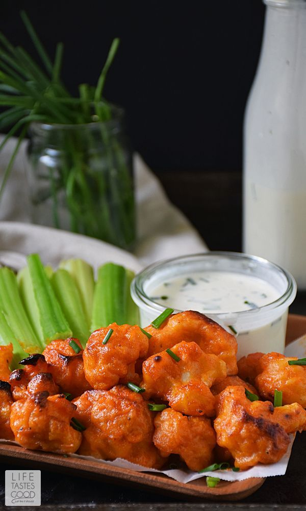 Baked Buffalo Cauliflower Bites | by Life Tastes Good with a dairy-free ranch dipping sauce are loaded with all the flavors of one of our favorite Monday Night Football appetizers, but in a better-for-you option. These spicy bites are meatless and dairy free too! #LTGrecipes
