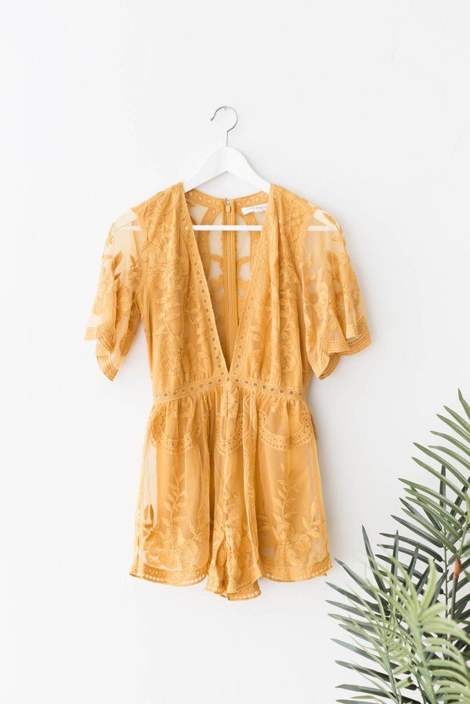 Gorgeous embroidered lace romper with a plunging V neckline. Hidden back zipper for easy on and off closure. Non-stretch lace with stretchy knit lining.  100% P
