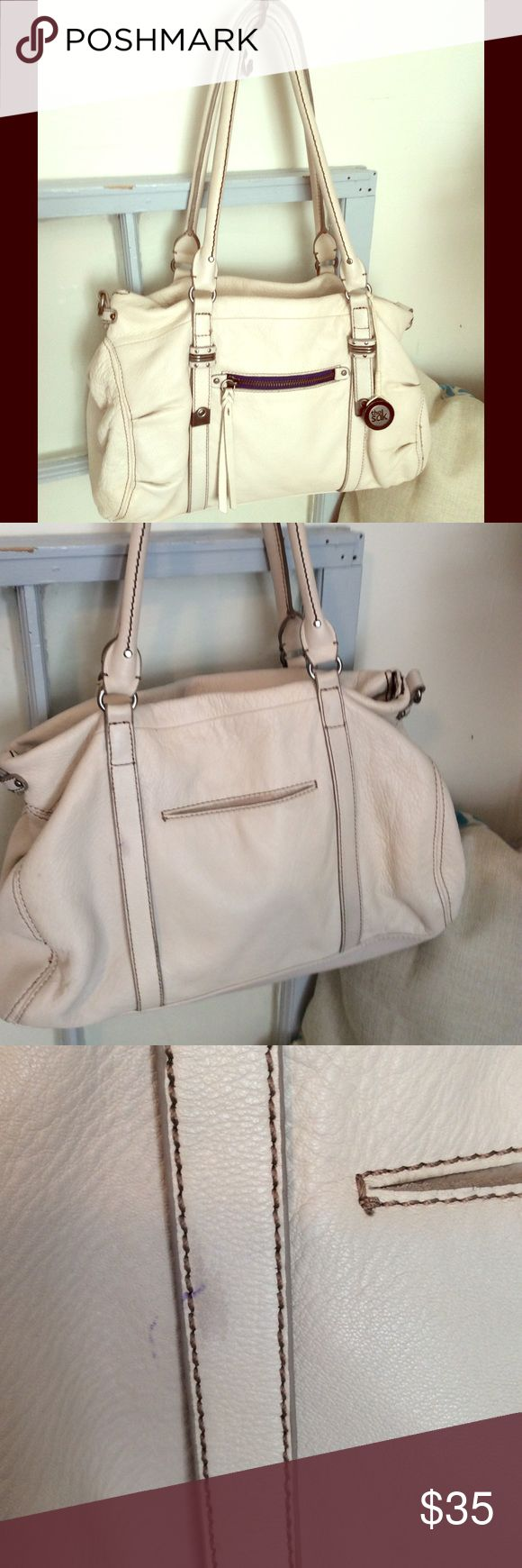The SAK cream shoulder bag . The SAK cream colored shoulder bag is very roomy. Interior is deep and has zipper pocket  and two organization slots . Very clean. Only flaw is  a pen spot on backside shown in pix # 3 close  up and pix # 2  hanging up. Great bag. The Sak Bags Shoulder Bags