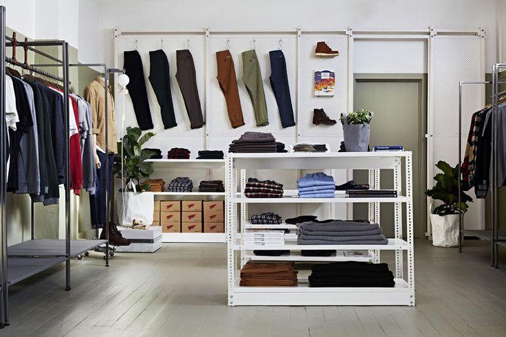 Perforated metal shelving - insert perpendicular hooks for tshirt racks.
