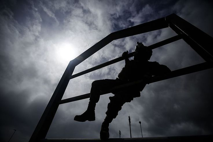 File:Lance Cpl. James Daves climbs an obstacle.jpg