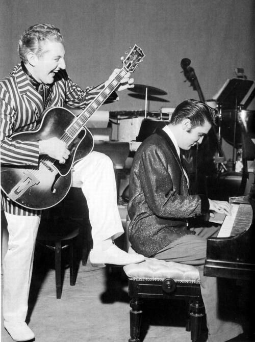 """Jamming, 1956...Jerry Lee Lewis and Elvis. The """"Million Dollar Quartet"""" - Elvis Presley, Carl Perkins, Johnny Cash and Jerry Lee Lewis - records old gospel, country and pop songs at an impromptu session. The recordings aren't officially released until the mid-Eighties."""