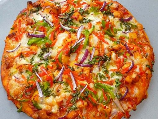 Chili paneer desi pizza Ingredients for Marinade  1. 1 Block of Paneer/ Cut into small cubes  2. 2tsp Tomato Puree  3. 2tsp Tabasco Sauce  4. 2 Clove Garlic, Crushed  5. 2tsp Chilli Sauce  6. 1 tsp Dried Oregano  7. 2 Green Chilli, Finely Chopped  8. Salt to Taste  9. Pepper  Ingredients for Pizza Sauce  1. 2tbsp Olive Oil  2. 1 Clove Garlic, Finely Chopped  3. 1 Tomato Can, 400g (blended)  4. Pinch of Dried Mixed Herbs  5. Salt to taste  6. ½ tsp Sugar