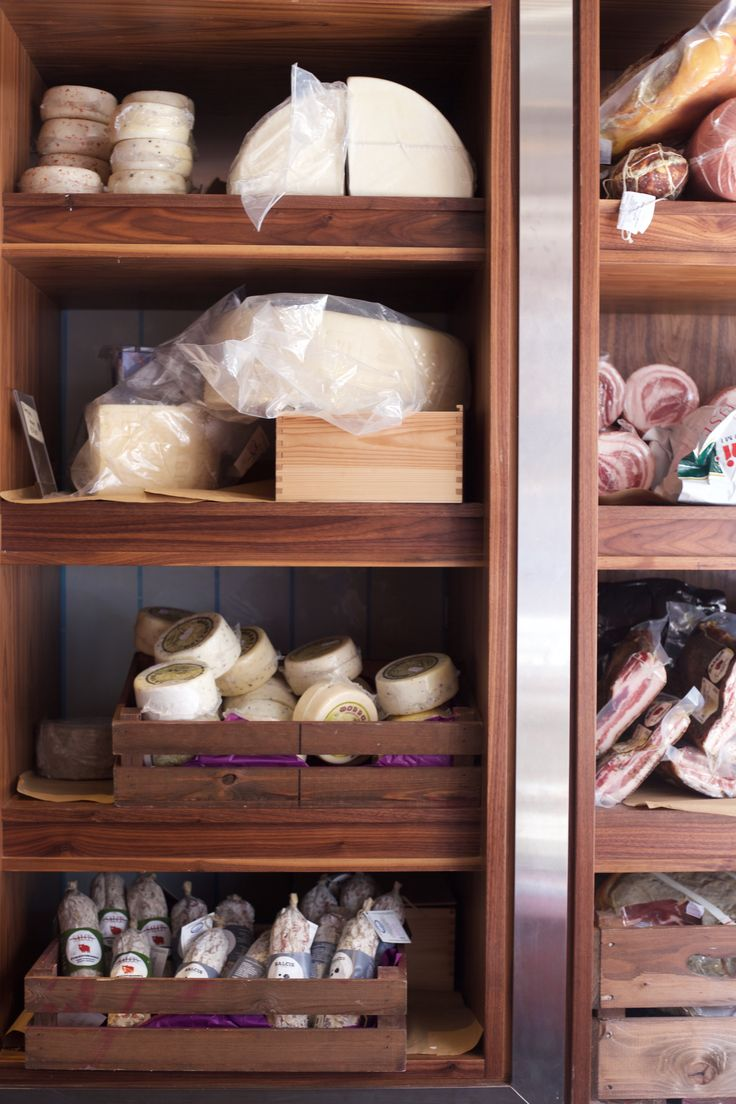 Cheeses in our refrigerated cave