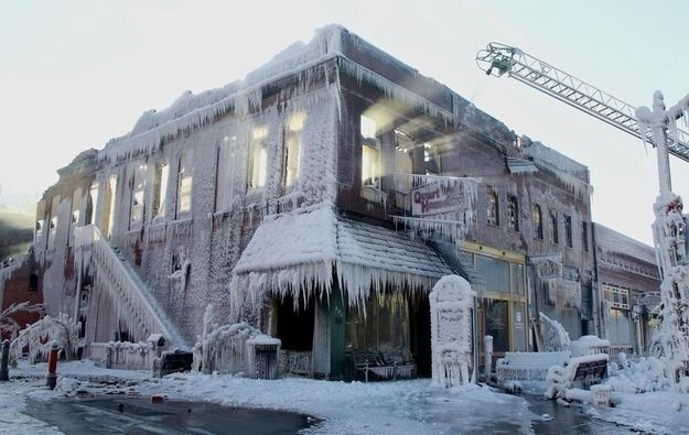 Beautifully Haunting Photos Of A Burning Building Transformed Into An Ice Castle