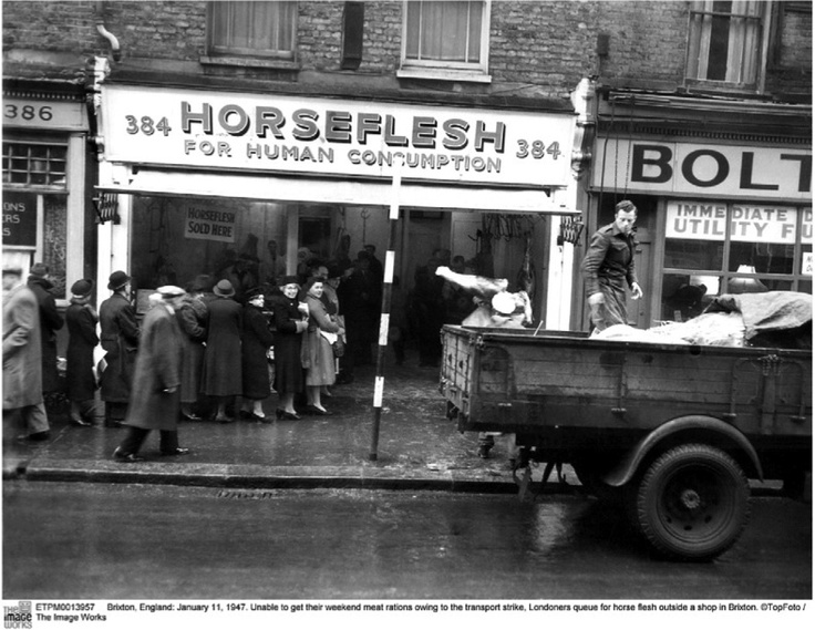 Brixton, England: January 11, 1947. Unable to get their weekend meat rations owing to the transport strike, Londoners queue for horse flesh outside a shop in Brixton. ©TopFoto / The Image Works
