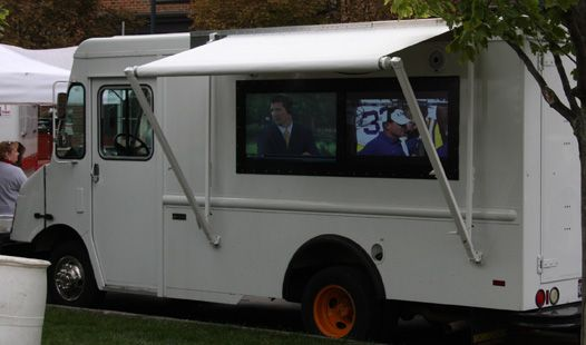 Like the screens for outside viewers. This happens to be a tailgate party vehicle with a frig big enough for  kegs of beer.  Let's see, what could we use that space for ...