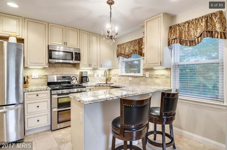 """New custom Mediterranean kitchen with 42"""" soft close cabinets, Bianco Antico granite with double ogee edges, marble floors and backslash, SS appliances, LED under cabinet lights."""