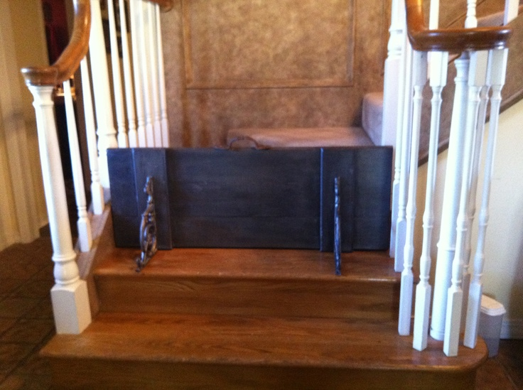 Custom Dog Gate: I took an exterior shutter, cut to size, painted and glazed; added decorative brackets to one side and attached a metal decorative handle. Looks great, and is easy to pick up and sit up on the landing to allow access up the stairs.                                                                                                                                                                                 More