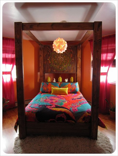 amazing bohemian bedroom decor ideas with wooden canopy bed design with chic pink curtain as well as orange wall paint color scheme - Bohemian Bedroom Design