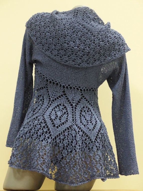 This is a knit open front cardigan made of cotton and viscose yarn. It has a unique look thanks to the gorgeous lace that is completely handmade.