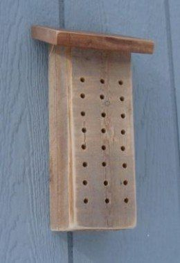DIY plans with step-by-step instructions for making a mason bee house.