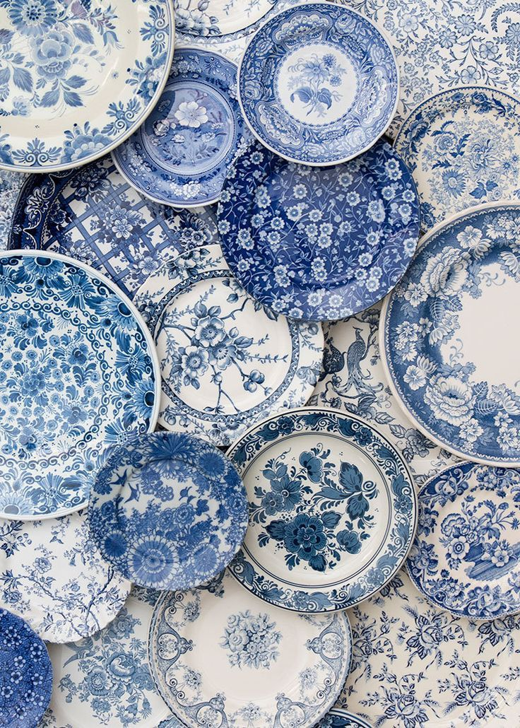 love all the blue and white patterns on these plates. Photo from Casa de Perrin.