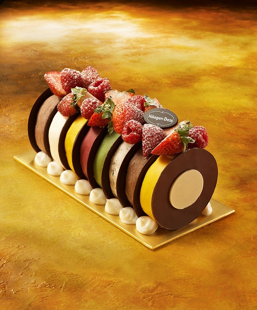 The Rainbow Log is made of Häagen-Dazs' most special ice cream and sorbet flavors, housed between thin layers of dark chocolate and topped with berries.