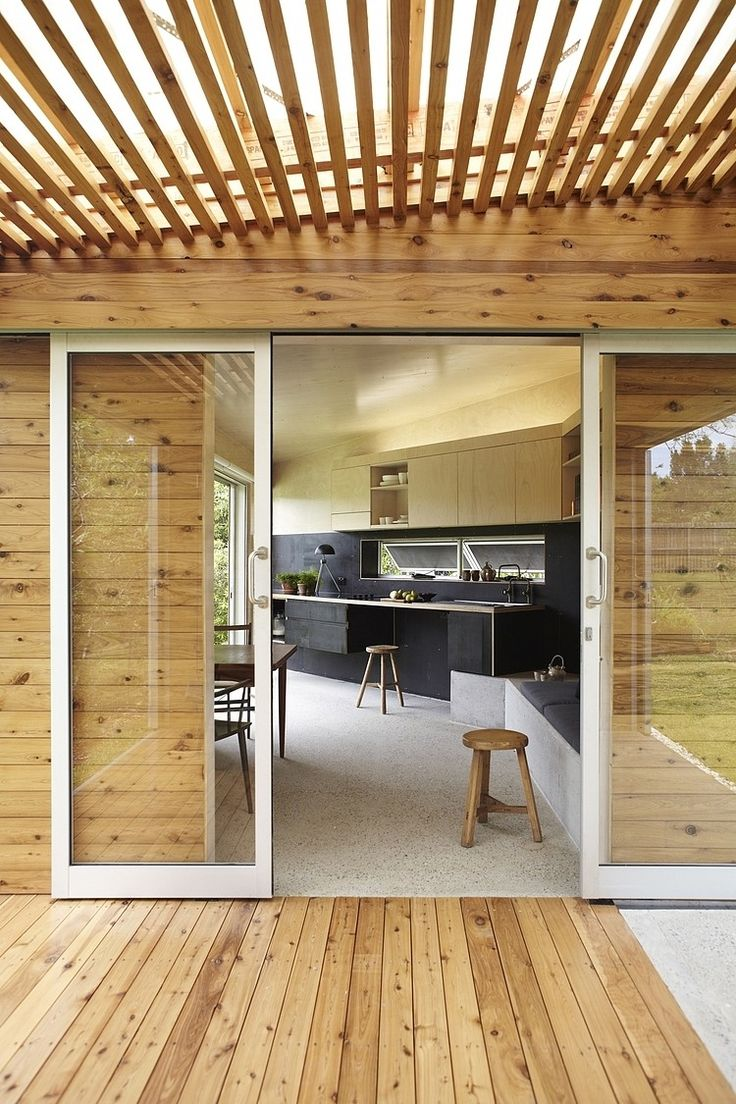Keperra House by A–CH.  Beautiful sliding glass doors that contrast with the use of wood. The wood establishes a nice visual rhythm and pattern, subtly welcoming the person with parallel lines heading towards the doorway.