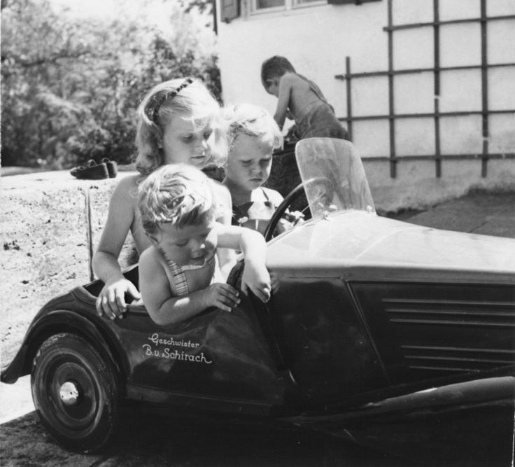 Baldur von Schirach's children. In toy car: Angelika, Robert, and Richard. Outside of car: Klaus. Photo taken: about 1944-1945.