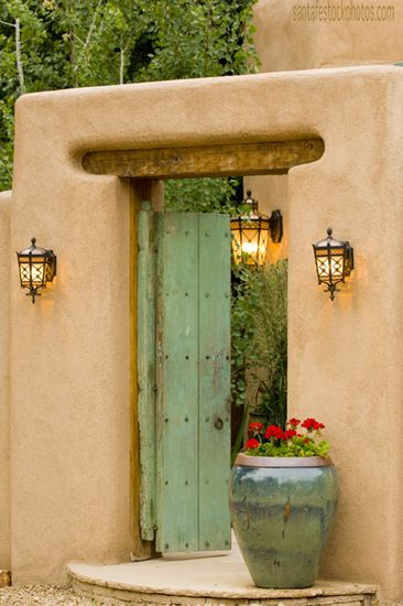 Green Door with geranium ...love how the door and pot coordinate colors