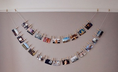 clothesline picture display.  laura miner.
