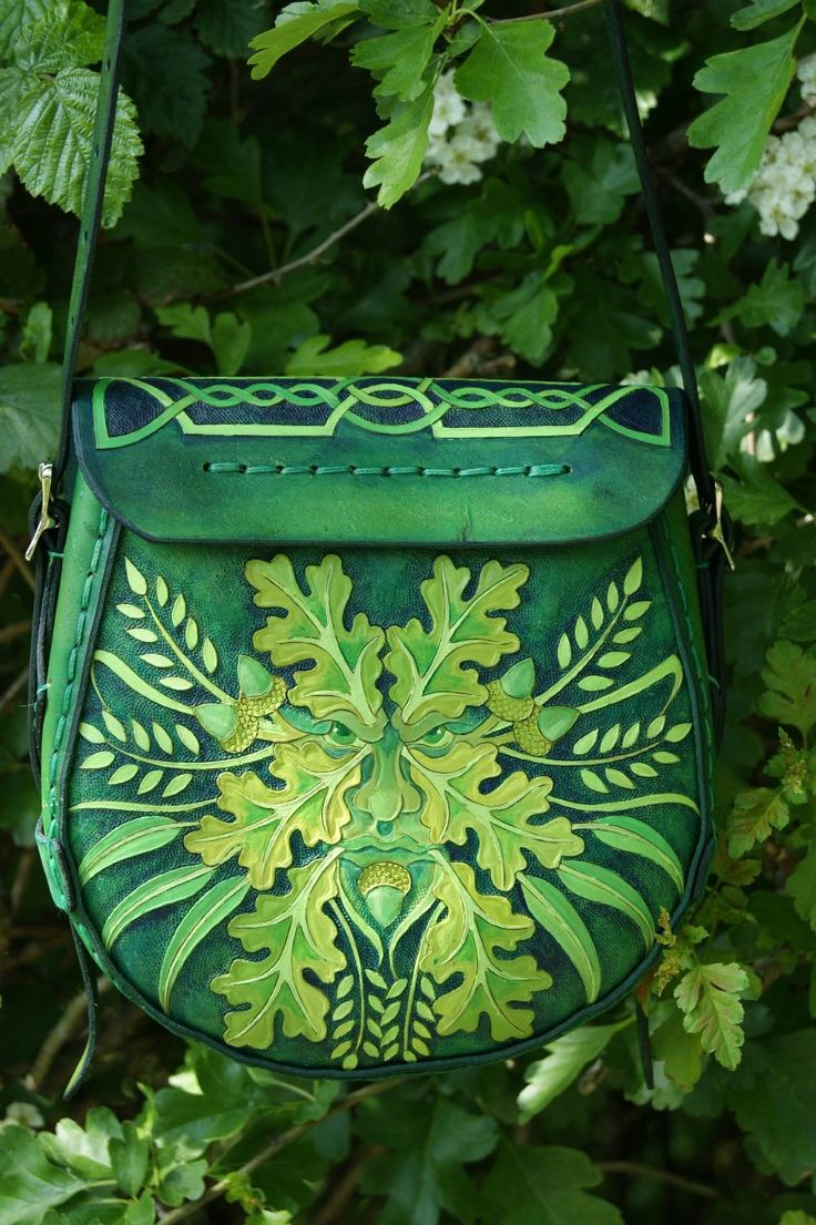 Elaborately detailed medium sized bag with Tree Of Life flap, knotwork and Green Man back
