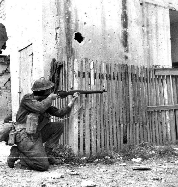 "Canadian rifleman aims at the enemy during the Battle of Ortona (Dec 20-28,1943) Italy, the battle nicknamed ""little Stalingrad"" due to the vicious close quarters fighting that took place with the defending German paratroopers. The Canadian in this picture deploys the Rifle No.4 Mk1, an evolution of the Lee-Enfield .303 of WW1 vintage."