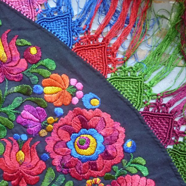 Stunning vintage Matyo table cloth Heavily embroidered Matyo roses and tulips on a black cotton with traditional knotted and woven fringes along the