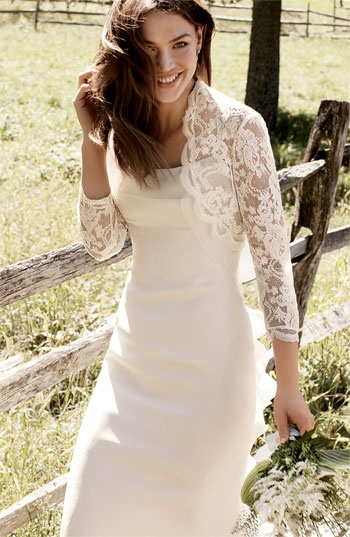Nordstrom. Scalloped trim frames the neckline of an open-front lace shrug, styled with three-quarter sleeves.