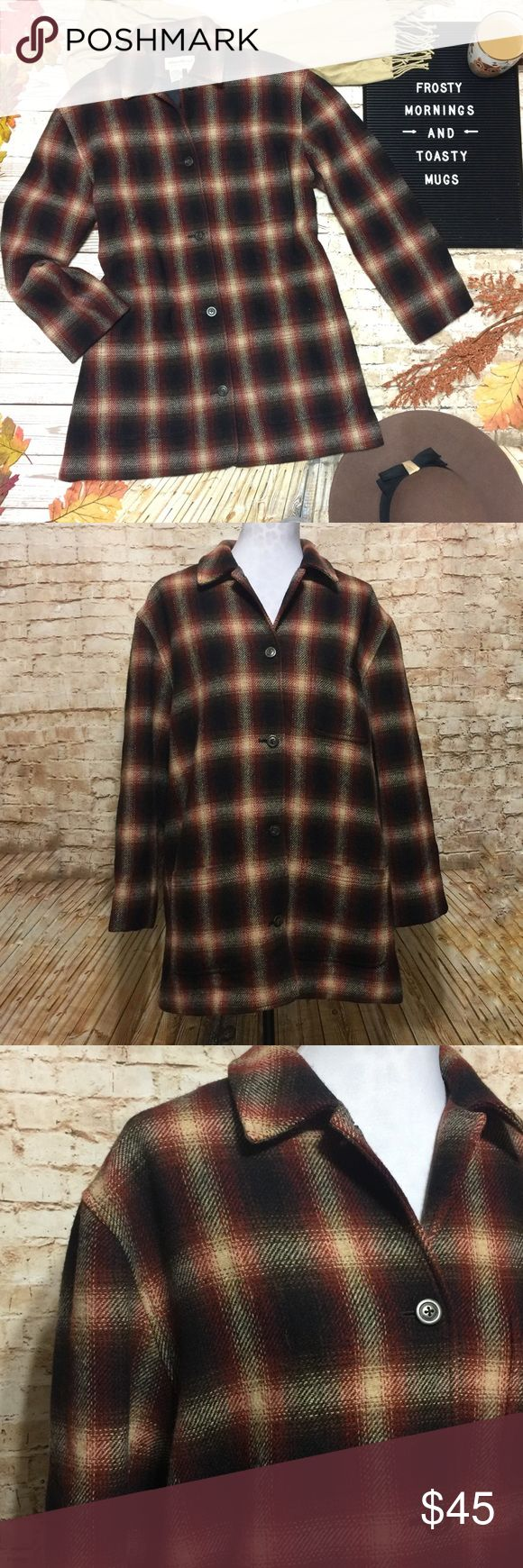 """Eddie Bauer Plaid Wool-Blend Coat Beautiful wool blend coat by Eddie Bauer in a gorgeous tartan plaid. Black, cream, tan and rust colored plaid. Button front. Collar. Three pockets. Longer length hits mid-thigh depending on your height. Fully lined. 85% Wool and 15% nylon. Very warm. Flawless condition.   Measurements lying flat: • Bust: 23.5"""" from armpit to armpit  • Length: 32.5"""" Eddie Bauer Jackets & Coats Pea Coats"""