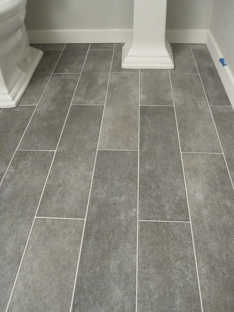 Wide plank tile for bathroom. Great grey color!    would love for both bathrooms.