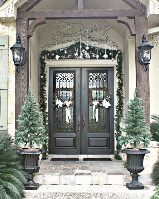 {Christmas Home Tour} - Notice the branch twigs holdings the hanging ornaments. An elegant entrance! janis-allthingsbeautiful.com