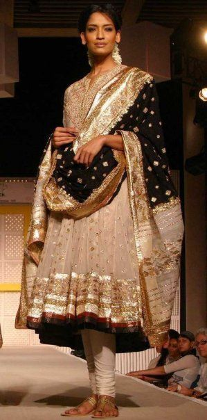 Cream, gold and black anarkali. Indian fashion.