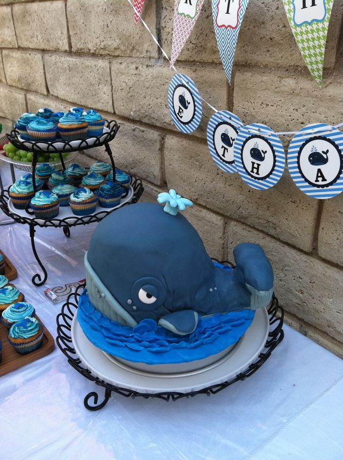 I made this for my neighbor?s 5-year-old birthday party and he really wanted a whale themed party. So I got the idea Cakesaurus' whale cake and tried to make it my own.  The main part of the whale is cake and the back end and tail is rice crispy treats. I think if I practice the tail more it would've been perfect, but I think it was awesome for my first attempt at sculpting cake.