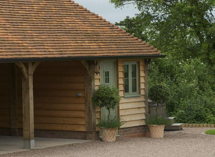 Carport with storage area - Border Oak