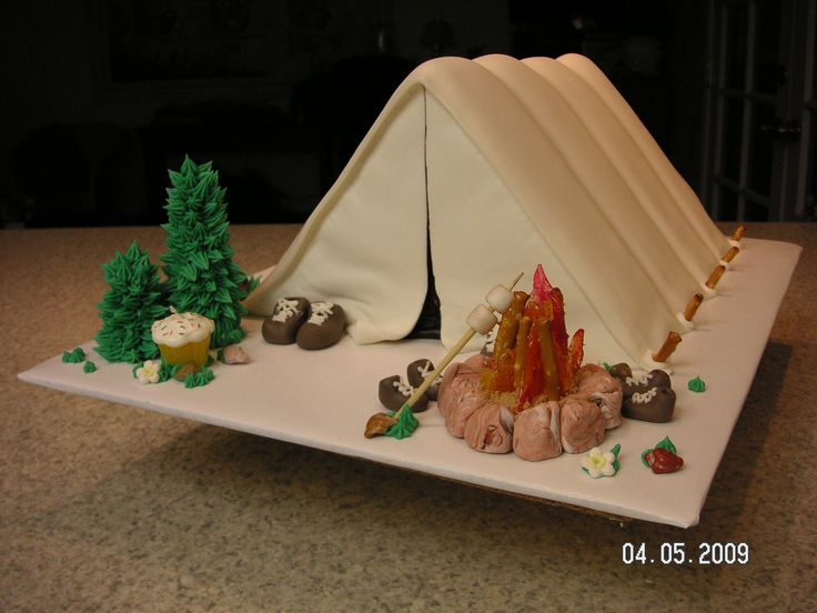 Tim's Tent Cake - Square cakes cut in half diagonally, placed on end, covered in fondant. The flames are made from crushed cinnamon and butterscotch candies, melted on crumpled (buttered) foil in the oven and then swirled.