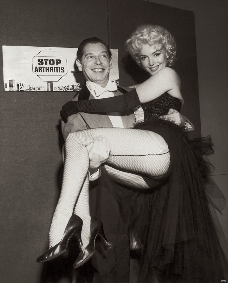 Marilyn Monroe with Milton Berle at The Ringling Bros Circus. March 30, 1955