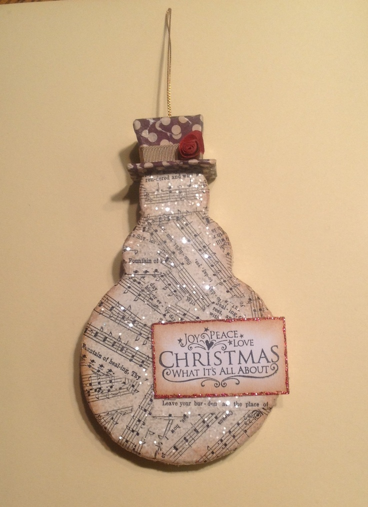 Christmas ornament using paper mâché snowman from Hobby Lobby covered in vintage music paper