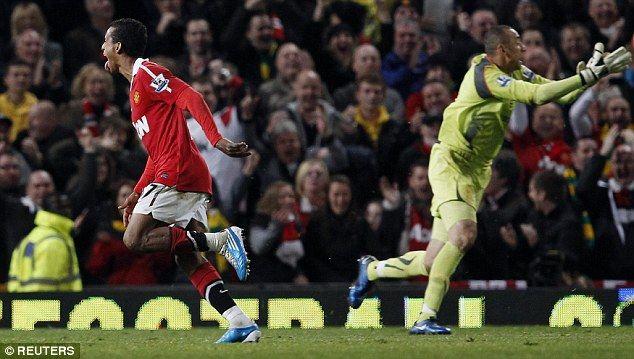 Manchester United winger Nani (left) runs away in celebration asHeurelho Gomes protests