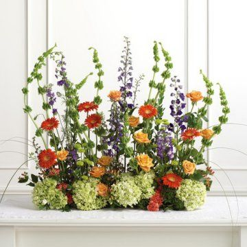 An arrangement like this looks good at the front foot of an altar or the lecterns
