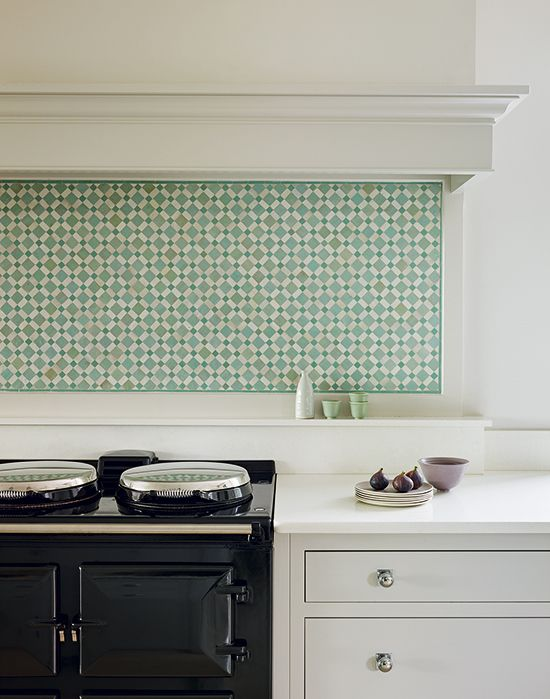 Mosaic tiles add beautiful pattern to this muted scheme | Kitchen designed by Toni Silver of martinmoore.com | Homes & Gardens | Photograph Darren Chung | http://www.hglivingbeautifully.com/2016/04/27/dream-rooms-a-carefully-composed-kitchen-in-worcestershire/