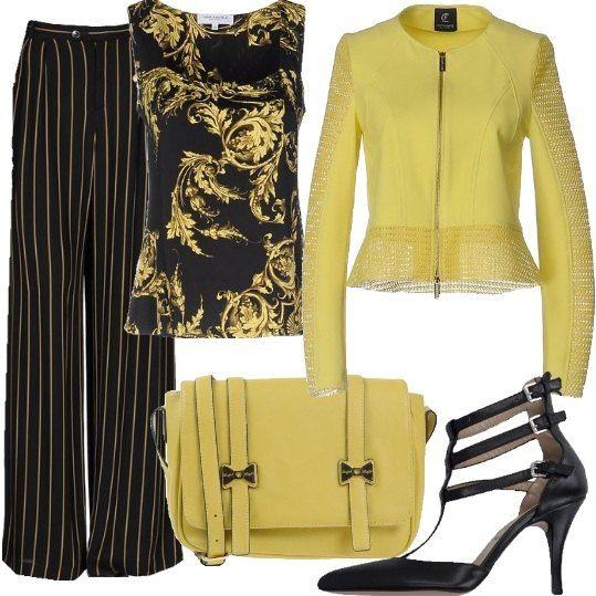 Il giallo, colore vibrante, dà una sferzata di positività e di allegria anche al look più classico. La proposta di oggi vede un mix e match di fantasie su una base in nero, per un look più adatto alle ladies, pantalone in crêpe, a righe, modello a gamba ampia, vita alta, coordinabile con il top a fantasia floreale. Giubbotto giallo in jersey, traforato abbinato alla tracolla con applicazioni smaltate a contrasto e décolleté nere con cinturini e punta stretta.