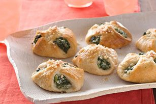 1 can crescent rolls, 1 package defrosted spinach, 1 package softened cream cheese,  chopped green onions, 1/2 cup mozzarella cheese,  1/3 cup parmesan cheese, garlic, egg yolk. Cut crescent in half, fill with mixture, brush with egg white. Bake at 375 for 12 min or so. Yummy!