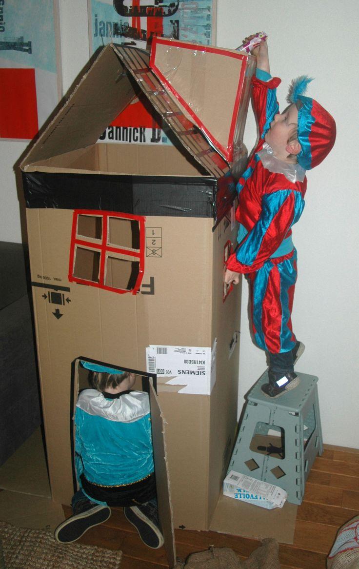 Namaak pakjes (kartonnen doosjes zelf inpakken met sinterklaaspapier), door de schoorsteen gooien. Zo toch een beetje oefenen als piet. Huisje is gemaakt van een koelkastdoos.