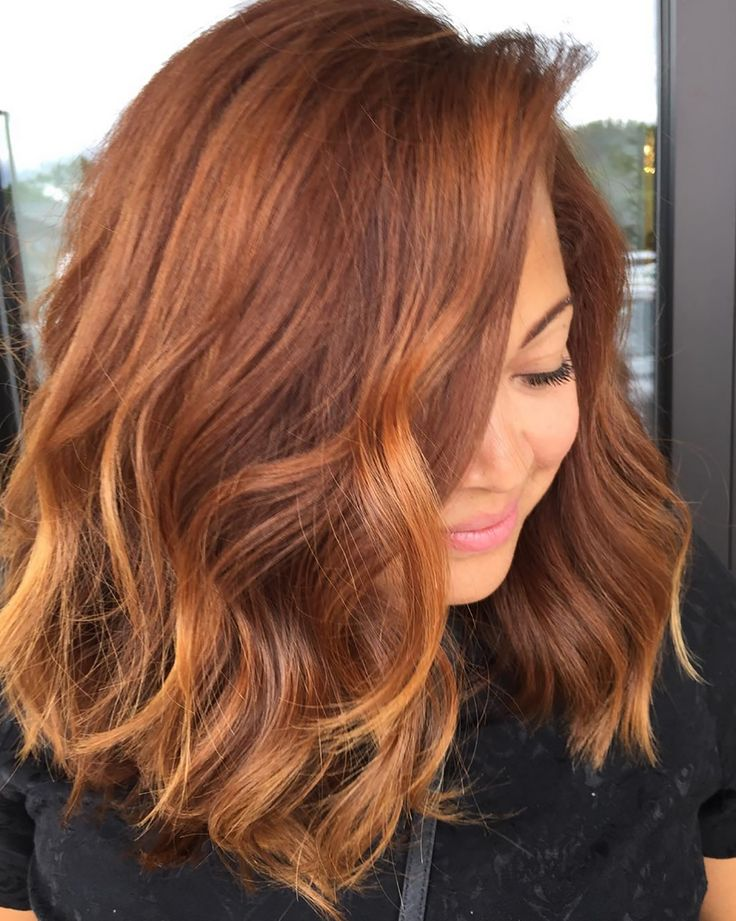 "The warm red tones of ""pumpkin spice hair"" are perfect for fall."