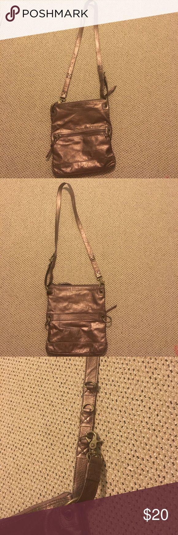 The sak crossbody metallic purse Lightly used / in good condition / adjustable strap The Sak Bags Crossbody Bags